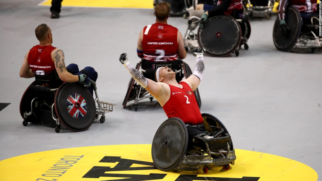 Mark Peters celebrates Thursday, September 28, after Denmark defeated the United Kingdom in the wheelchair rugby final of the Invictus Games.