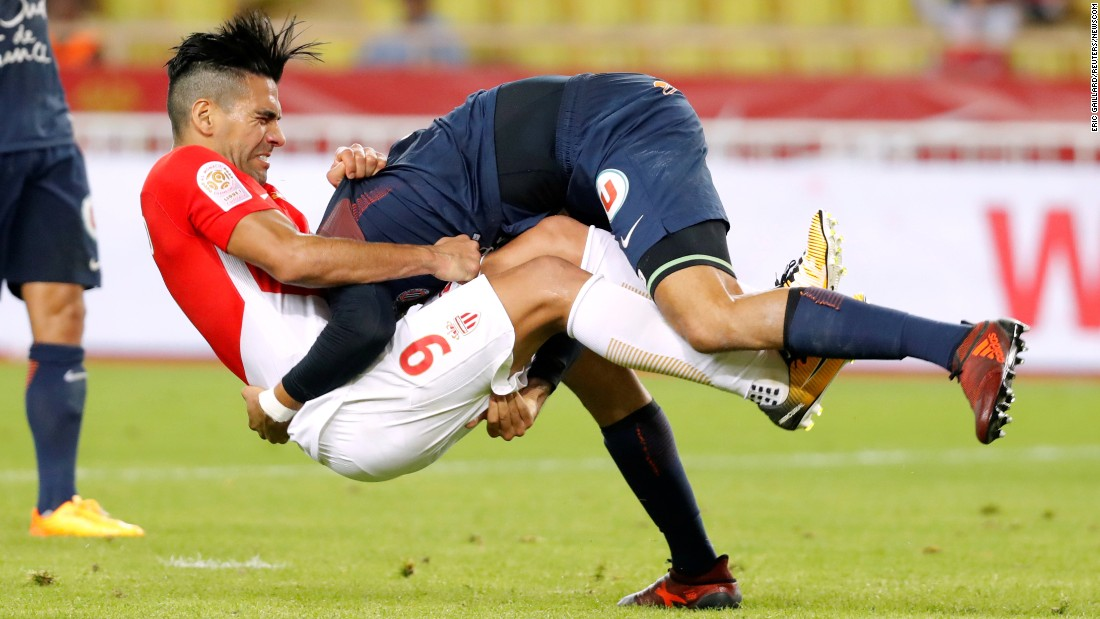 Monaco's Radamel Falcao, left, collides with Montpellier's Pedro Mendes during a French league match in Monaco on Friday, September 29.