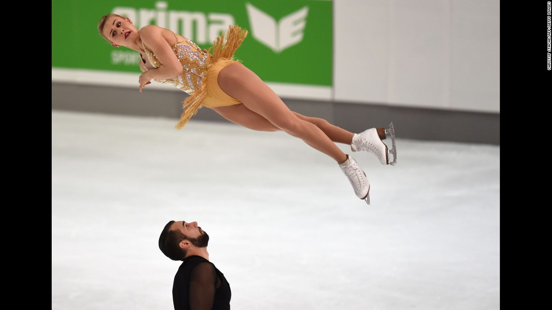Figure skater Ashley Cain twists in the air Friday, September 29, as she and Timothy Leduc perform during the Nebelhorn Trophy competition in Oberstdorf, Germany.