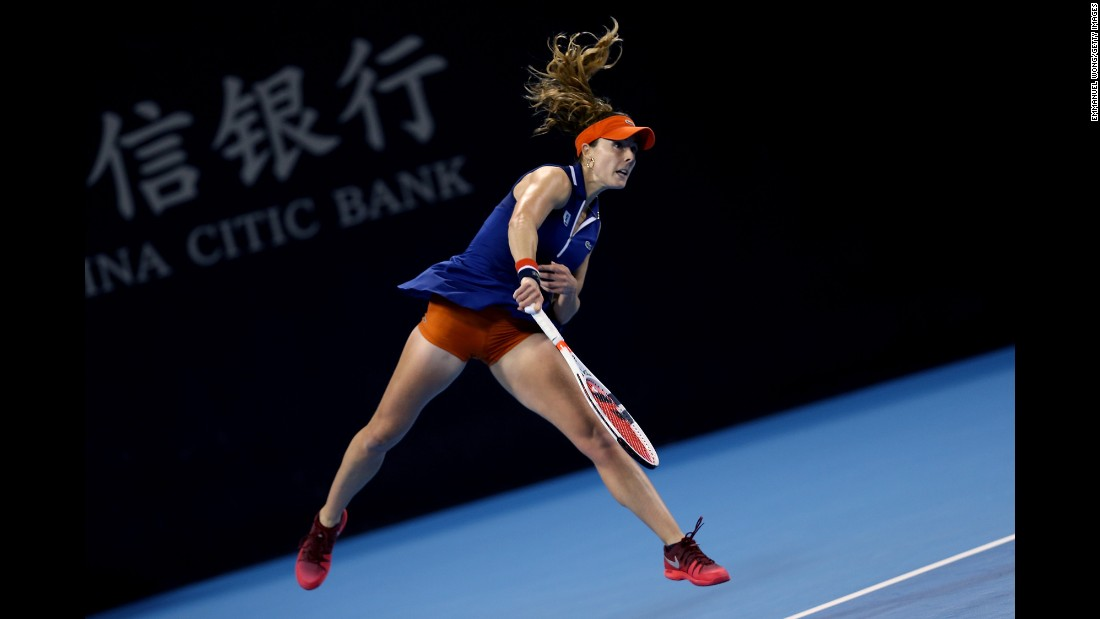 Alize Cornet serves the ball to Angelique Kerber during a China Open match in Beijing on Sunday, October 1.