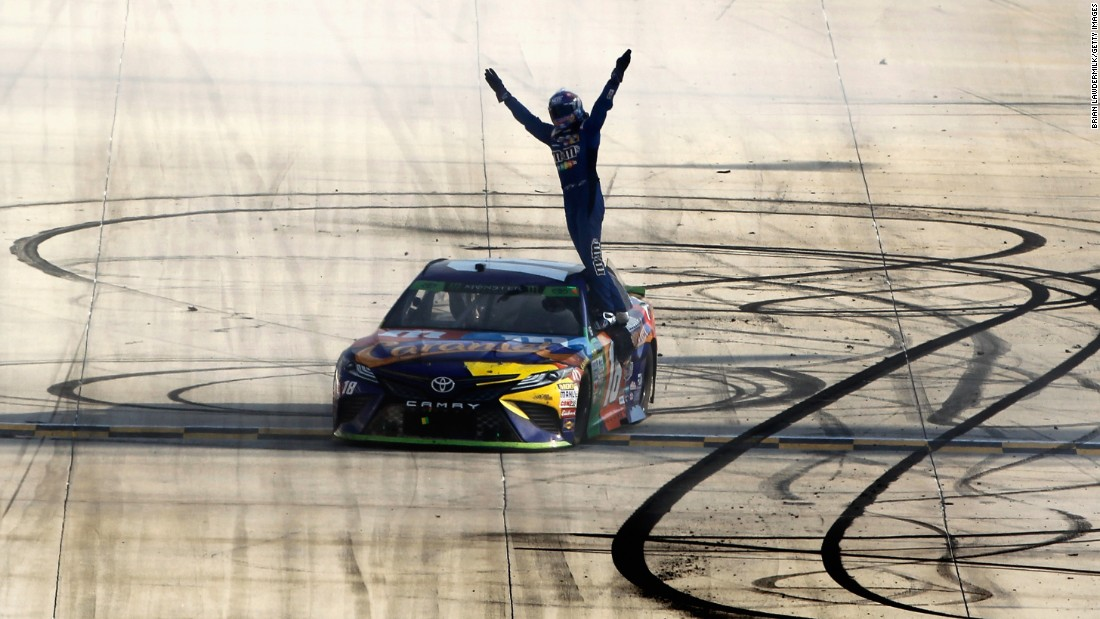 NASCAR driver Kyle Busch celebrates after winning the Cup Series race in Dover, Delaware, on Sunday, October 1. It was his second straight victory. He also won last week in New Hampshire.