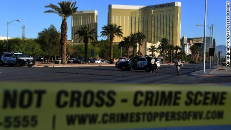Crime scene tape surrounds the Mandalay Hotel (background) after a gunman killed at least 50 people and wounded more than 200 others when he opened fire on a country music concert in Las Vegas, Nevada on October 2, 2017. 
