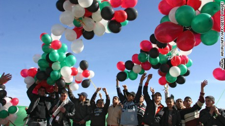 RAMALLAH, -:  Fatah supporters release balloons in the air near the gravesite of late Palestinian leader Yasser Arafat in the West Bank city of Ramallah , as the electoral campaign was launched, 03 January 2006. Campaigning began today for the January 25 Palestinian parliamentary election, with factions staging launch rallies despite major question marks hanging over whether the vote will take place. The Fatah movement, which has governed the Palestinian Authority over the past decade, will kick off its campaign in the West Bank, while its chief rivals from Hamas will stage their own launch in their Gaza Strip stronghold. AFP PHOTO/JAMAL ARURI  (Photo credit should read JAMAL ARURI/AFP/Getty Images)