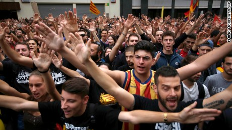 Protestors gather in front of the Spanish Partido Popular ruling party headquarters in Barcelona, Spain.