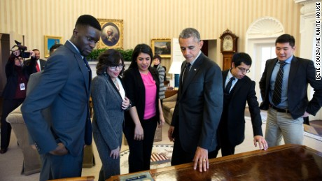 President Barack Obama shows the Resolute Desk to a group of DREAMers, following their Oval Office meeting in which they talked about how they have benefited from the Deferred Action for Childhood Arrivals immigration reform program, Feb. 4, 2015. (Official White House Photo by Pete Souza)