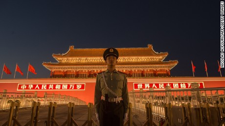 A Chinese paramilitary police officer secures the front gate of the Forbidden City in Beijing on September 28, 2017.  China will convene its 19th Party Congress on October 18, state media said, a key meeting held every five years where President Xi Jinping is expected to receive a second term as the ruling Communist Partys top leader. / AFP PHOTO / NICOLAS ASFOURI        (Photo credit should read NICOLAS ASFOURI/AFP/Getty Images)