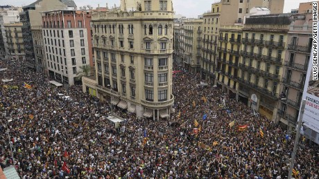 Protesters gather at the Placa de la Universitat square in Barcelona in Tuesday's day of protest against police violence.