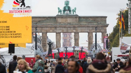 "Germans celebrate the ""Day of German Unity"" at the Brandenburg Gate in Berlin. The monument stood in no-man's land, between East and West Berlin, until 1989."