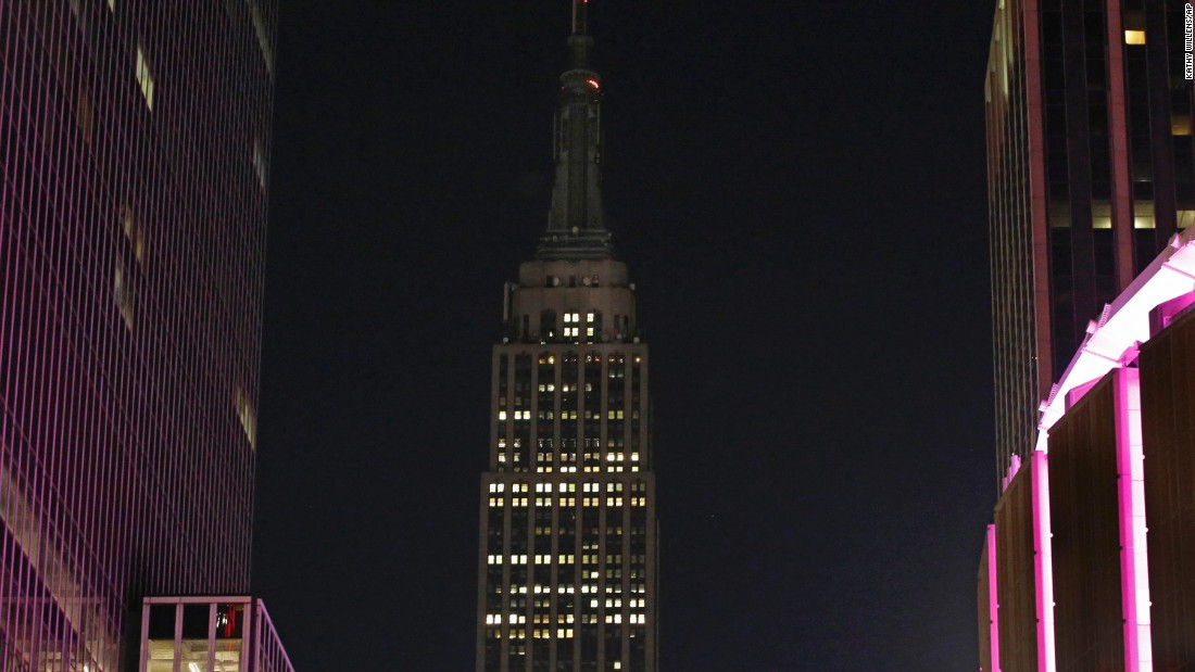 The lights of the Empire State Building are dimmed in New York on October 2.