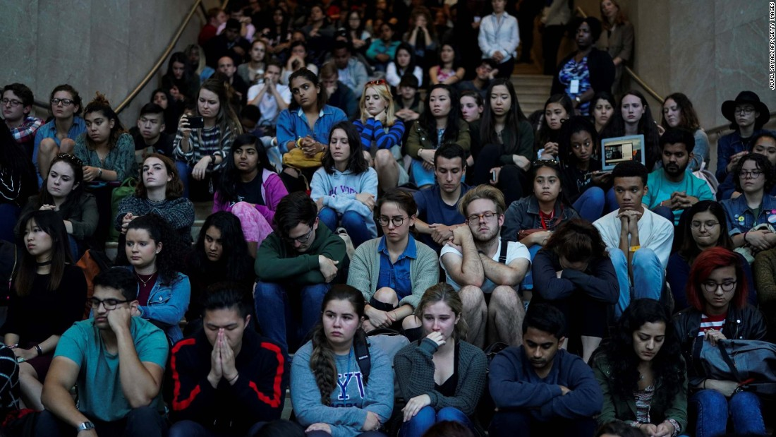 New York University students attend a vigil on October 2.