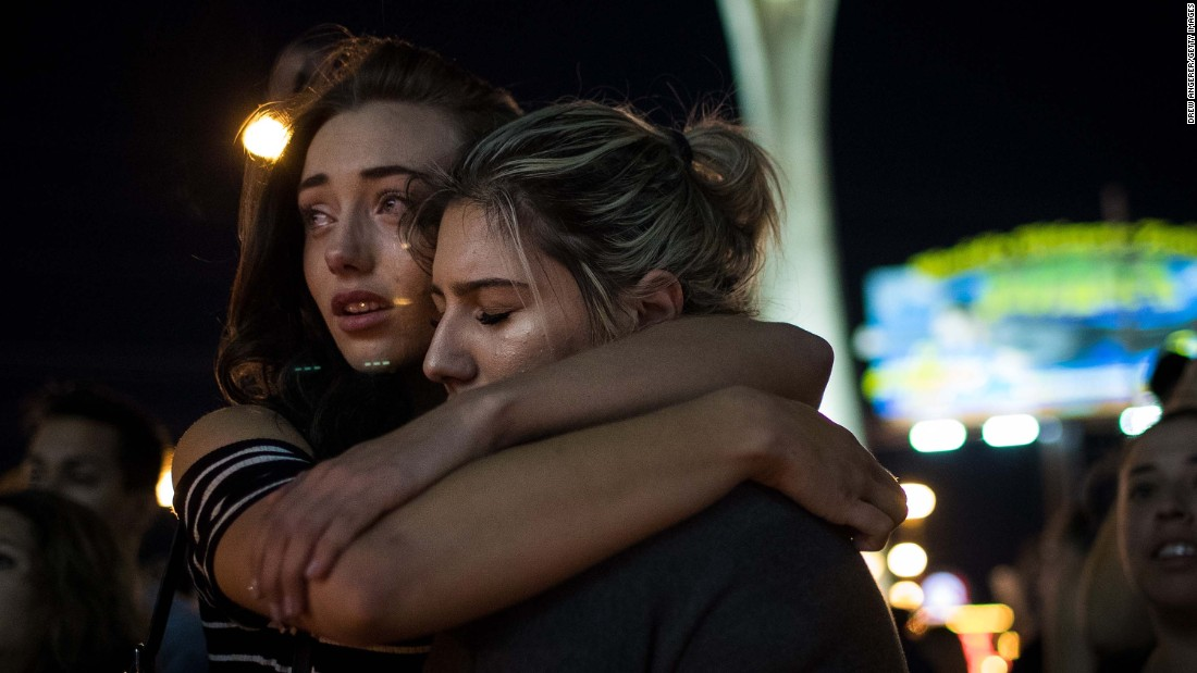 Mourners attend a vigil at the corner of Las Vegas Boulevard and Sahara Avenue on October 2.