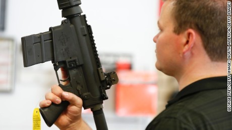 SPRINGVILLE, UT - JUNE 17:  David Barkerlooks at an AR-15 semi-automatic gun to  at Action Target on June 17, 2016 in Springville, Utah. Semi-automatics are in the news again after the nightclub shooting in Orlando F;lord last week. (Photo by George Frey/Getty Images)