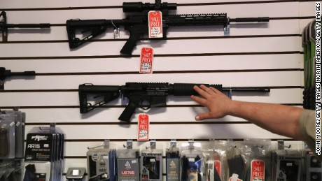 "BENSON, AZ - SEPTEMBER 29:  Gun shop owner Jeff Binkley displays AR-15 ""Sport"" rifles at Sarge's Sidearms on September 29, 2016 in Benson, Arizona. He said he redesigned and renamed his store just this year. Gun shops are proliferate in Arizona, which regulates and restricts weapons less than anywhere in the United States.  (Photo by John Moore/Getty Images)"