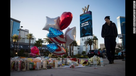 LAS VEGAS, NV - OCTOBER 3: Matthew Helms, who worked as a medic the night of the shooting, visits a makeshift memorial for the victims of Sunday night's mass shooting, on the north end of the Las Vegas Strip, October 3, 2017 in Las Vegas, Nevada. The gunman, identified as Stephen Paddock, 64, of Mesquite, Nevada, allegedly opened fire from a room on the 32nd floor of the Mandalay Bay Resort and Casino on the music festival, leaving at least 58 people dead and over 500 injured. According to reports, Paddock killed himself at the scene. The massacre is one of the deadliest mass shooting events in U.S. history. (Photo by Drew Angerer/Getty Images)