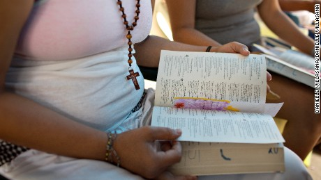 Women read from the Bible at El Salvador's Ilopango prison, which teaches inmates skills such as knitting, piata-making, painting, dancing, aerobics, reading, and cosmetology, among others.