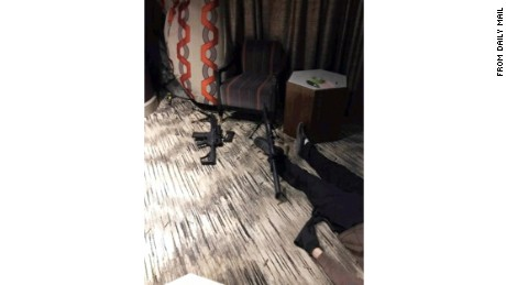 Photos published by the Daily Mail of the United Kingdom show a body   inside Stephen Paddock's room at the Mandalay Bay.