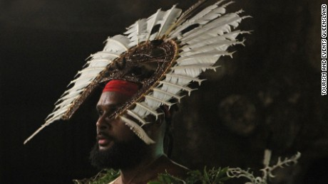Australian NBA star Patty Mills wears a shark headdress on his ancestral island of Mer off Far North Queensland.