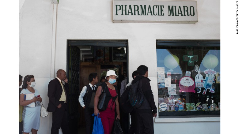 People queue at a pharmacy in downtown Antananarivo, Madagascar to buy protection masks against infections and medicines against plague on Monday, October 2.