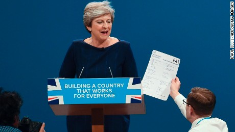 A protester interrupts Theresa May at the Conservative Party annual conference in Manchester on 4 October 2017.