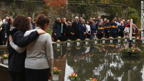 Victims' relatives and community members lay floral tributes at Port Arthur, Australia, on April 28, 2016, to mark the 20th anniversary of the massacre in which 35 people were killed.