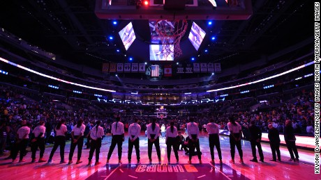 Minnesota Lynx players stand up for the National Anthem as the Los Angeles Sparks stay in their locker room during Game 3 of the WNBA Finals at Staples Center last week in Los Angeles.