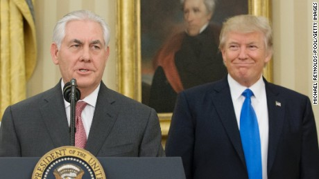 WASHINGTON, DC - FEBRUARY 1:  (AFP OUT) Rex Tillerson delivers remarks after being sworn in as 69th secretary of state as President Donald Trump looks on beneath a painting of populist President Andrew Jackson in the Oval Office of the White House on February 1, 2017 in Washington, DC.