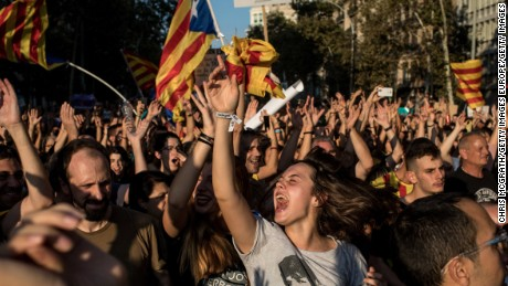 BARCELONA, SPAIN - OCTOBER 03:  People dance and sing songs as  thousands of citizens gather in Plaza Universitat during a regional general strike to protest against the violence that marred Sunday's referendum vote on October 3, 2017 in Barcelona, Spain. According to the Catalonia's government more than two million people voted on Sunday in the referendum of Catalonia, which the Government in Madrid had declared illegal and undemocratic. Officials said that 90% of votes cast were for independence. The Catalan goverment's spokesman said that an estimated of 770,000 votes were lost as a result of 400 polling stations being raided by Spanish police. Hundreds of citizens were injured during the police crackdown.  (Photo by Chris McGrath/Getty Images)