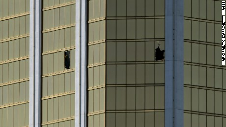 The damaged windows on the 32nd floor room that was used by the shooter in the Mandalay Hotel after a gunman killed at least 58 people and wounded more than 500 others when he opened fire on a country music concert in Las Vegas, Nevada on October 2, 2017.  Police said the gunman, a 64-year-old local resident named as Stephen Paddock, had been killed after a SWAT team responded to reports of multiple gunfire from the 32nd floor of the Mandalay Bay, a hotel-casino next to the concert venue. / AFP PHOTO / Mark RALSTONMARK RALSTON/AFP/Getty Images