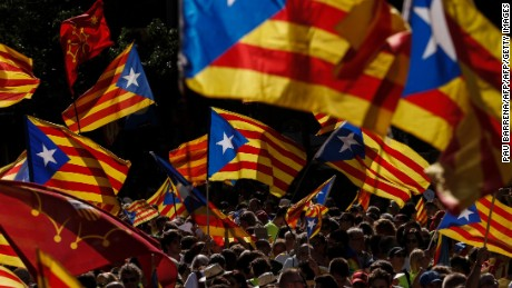 "People wave 'Esteladas' (pro-independence Catalan flags) as they gather during a pro-independence demonstration, on September 11, 2017 in Barcelona during the National Day of Catalonia, the ""Diada."" Hundreds of thousands of Catalans were expected to rally to demand their region break away from Spain, in a show of strength three weeks ahead of a secession referendum banned by Madrid. The protest coincides with Catalonia's national day, the ""Diada,"" which commemorates the fall of Barcelona in the War of the Spanish Succession in 1714 and the region's subsequent loss of institutions and freedoms.  / AFP PHOTO / PAU BARRENA        (Photo credit should read PAU BARRENA/AFP/Getty Images)"