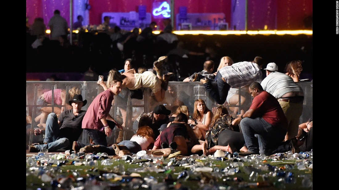 "Concertgoers dive over a fence to take cover from gunfire after shots rang out at a country music festival on the Las Vegas Strip on Sunday, October 1. At least 58 people were killed and almost 500 were injured when <a href=""http://www.cnn.com/2017/10/02/us/gallery/las-vegas-shooting/index.html"" target=""_blank"">a gunman opened fire</a> on the crowd. Police said the gunman, 64-year-old Stephen Paddock, fired from the Mandalay Bay hotel, several hundred feet southwest of the concert grounds. He was found dead in his hotel room, and authorities believe he killed himself. It is <a href=""http://www.cnn.com/2013/07/19/us/gallery/worst-shootings-in-us/index.html"" target=""_blank"">the deadliest mass shooting</a> in modern US history."