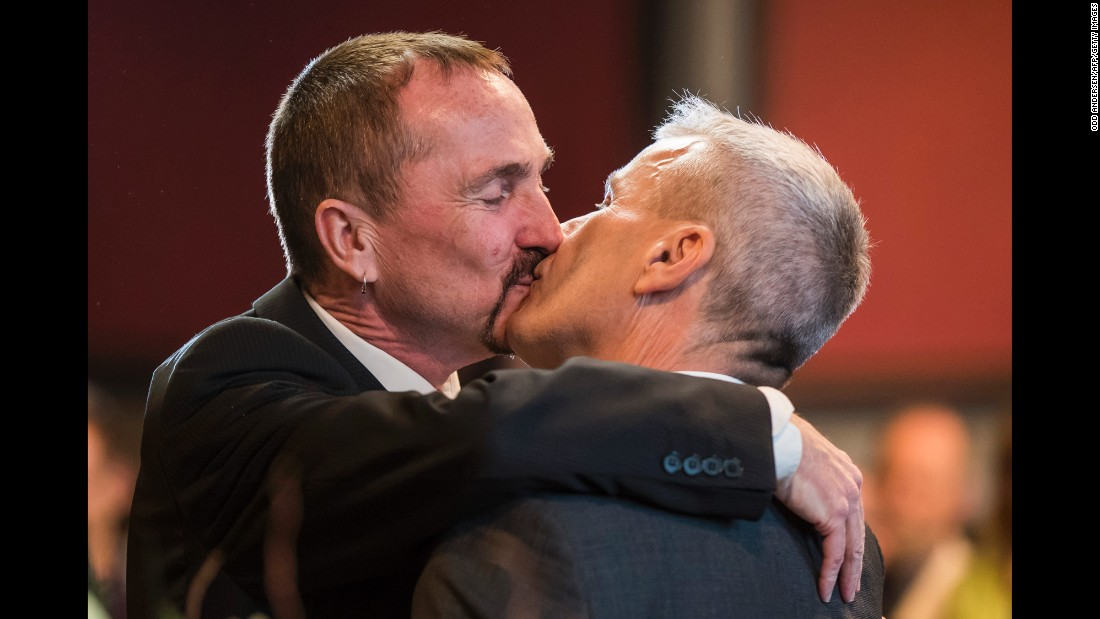 "Karl Kreile, left, and Bode Mende kiss Sunday, October 1, after becoming the first gay couple to be legally married in Germany. <a href=""http://www.cnn.com/interactive/2017/06/world/germany-same-sex-marriage-cnnphotos/"" target=""_blank"">Read more: 'Love wins' in Germany</a>"