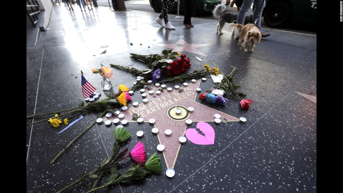 "Flowers, candles and cards adorn Tom Petty's star on the Hollywood Walk of Fame after <a href=""http://www.cnn.com/2017/10/03/entertainment/tom-petty-obit/index.html"" target=""_blank"">the rock legend died</a> Monday, October 2. Petty was 66 years old. <a href=""http://www.cnn.com/2017/10/03/entertainment/gallery/tom-petty/index.html"" target=""_blank"">Photos: The life and career of Tom Petty</a>"