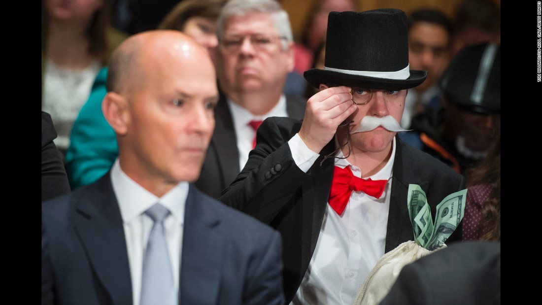 "Amanda Werner, dressed as the iconic Monopoly Man, sits behind former Equifax CEO Richard Smith as he testified before the Senate Banking Committee on Wednesday, October 4. The ruse was organized by progressive nonprofits Public Citizen and Americans for Financial Reform. ""I am dressed as the Monopoly Man to call attention to Equifax and Wells Fargo's use of forced arbitration as a get-out-of-jail-free card for massive misconduct,"" <a href=""http://money.cnn.com/2017/10/04/technology/culture/monopoly-man-equifax/index.html"" target=""_blank"">Werner said in a Twitter message to CNN Tech.</a> ""They use these ripoff clauses buried in the fine print to ensure that consumers can't join together to hold them accountable in court."" Last month, Equifax announced a huge data breach affecting over 145 million people. Smith told senators on Wednesday that a forced arbitration clause was not designed to be applied to the breach."