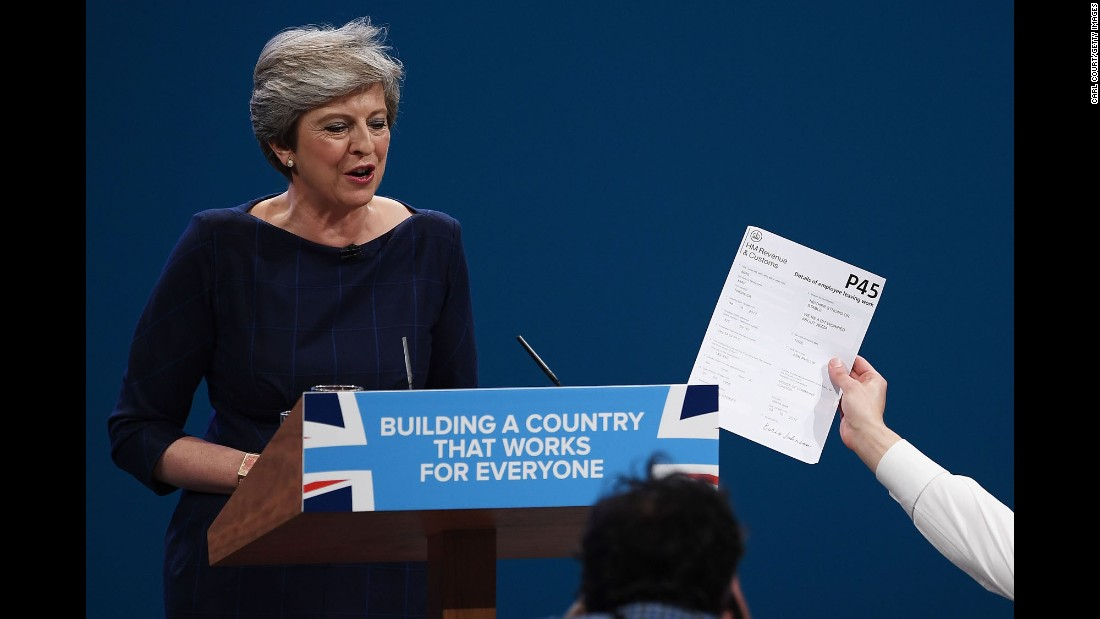 "Prankster Simon Brodkin<a href=""http://www.cnn.com/2017/10/04/europe/theresa-may-speech-disaster-conservative-party-conference/index.html"" target=""_blank""> interrupts a keynote speech</a> by British Prime Minister Theresa May, handing her a P45 form Wednesday, October 4, at the Conservative Party Conference in Manchester, England. A P45 is given to UK employees when they leave a company, similar to a ""pink slip"" in the United States. May managed to shrug off the incident as Brodkin was led away by security."