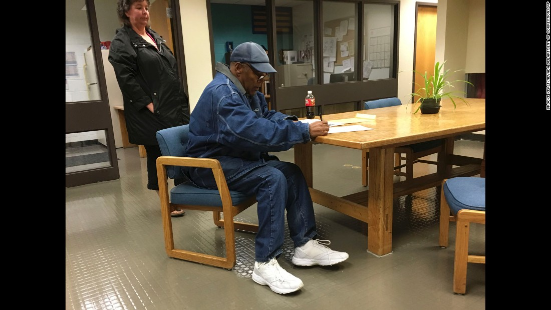 "O.J. Simpson signs documents as he is released from a prison in Lovelock, Nevada, on Saturday, September 30. The former football star, <a href=""http://www.cnn.com/2017/10/01/us/oj-simpson-released-from-prison/index.html"" target=""_blank"">now out on parole,</a> served nine years for kidnapping and armed robbery."