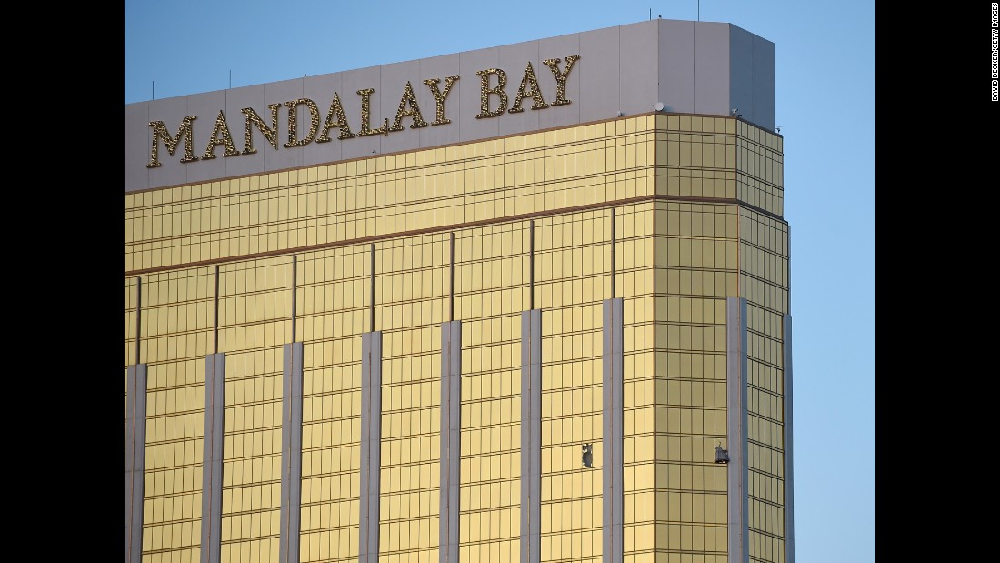"Broken windows of the Mandalay Bay hotel are seen early in Las Vegas on Monday, October 2, the morning after gunman Stephen Paddock <a href=""http://www.cnn.com/2017/10/02/us/gallery/las-vegas-shooting/index.html"" target=""_blank"">opened fire on a country music festival</a> nearby. Police say Paddock fired on the crowd from the 32nd floor of the hotel."