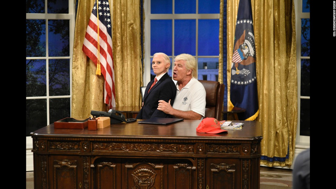 "Kate McKinnon, playing US Attorney General Jeff Sessions, sits on the lap of Alec Baldwin, playing President Donald Trump, during the opening sketch of ""Saturday Night Live"" on September 30."