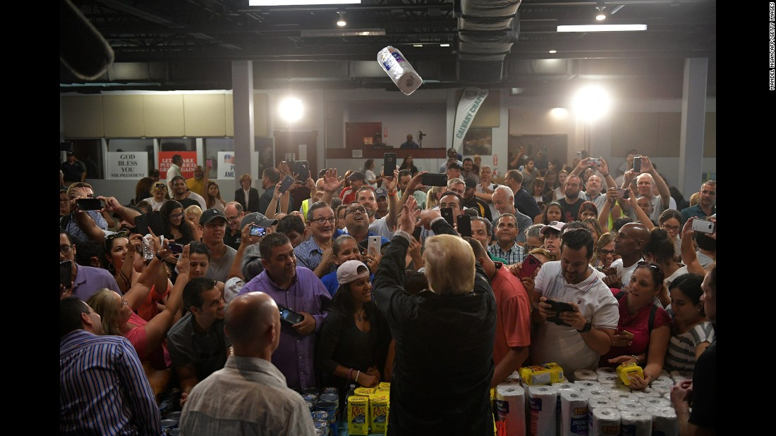 "US President Donald Trump <a href=""http://www.cnn.com/2017/10/03/politics/donald-trump-paper-towels-puerto-rico/index.html"" target=""_blank"">tosses a roll of paper towels</a> as he helps distribute supplies in Guaynabo, Puerto Rico, on Tuesday, October 3. Puerto Rico <a href=""http://www.cnn.com/interactive/2017/09/world/hurricane-maria-puerto-rico-cnnphotos/index.html"" target=""_blank"">was devastated by Hurricane Maria</a> two weeks ago."