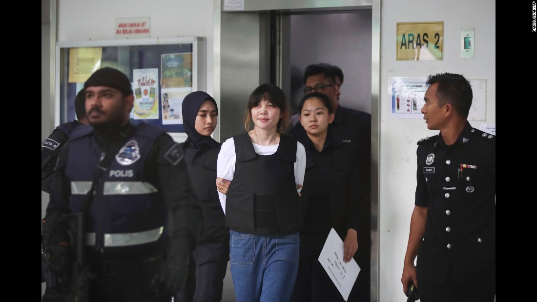 "Doan Thi Huong is escorted by police as she leaves a court hearing in Shah Alam, Malaysia, on Monday, October 2. Huong and Siti Aisyah <a href=""http://www.cnn.com/2017/09/30/asia/malaysia-kim-jong-nam-trial-siti-aisyah/index.html"" target=""_blank"">are accused of carrying out one of the most audacious assassination plots of the 21st century:</a> the murder of Kim Jong Nam, the half-brother of North Korean leader Kim Jong Un. Both have pleaded not guilty."
