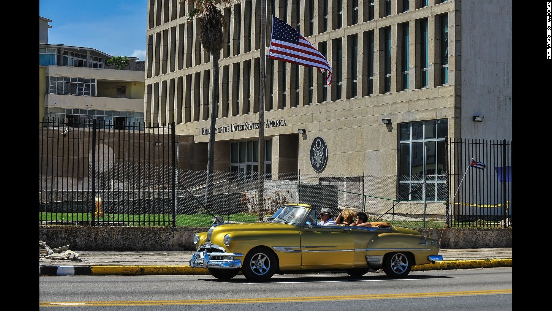 "A car drives by the US Embassy in Havana, Cuba, on Tuesday, October 3. The US State Department <a href=""http://www.cnn.com/2017/09/29/politics/us-cuba-sonic-attacks-pulls-out-diplomats/index.html"" target=""_blank"">is pulling all families of employees and nonessential personnel out from Cuba</a> after a string of mysterious attacks against US diplomats. Several US officials told CNN that 21 US diplomats and family members became ill after apparent sonic attacks. The embassy will continue to operate with a 60% reduction in staff."