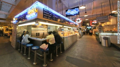 Grand Central Market is a popular gathering place for hungry tourists and locals. Inside the market, Sarita's Pupuseria serves up tasty Salvadoran food.