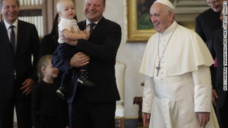 Pope Francis smiles with Prime Minister of Lithuania Saulius Skvernelis (L) carrying his son Tadas at the end of their private audience at the Vatican, on October 6, 2017. / AFP PHOTO / POOL / Alessandra TarantinoALESSANDRA TARANTINO/AFP/Getty Images