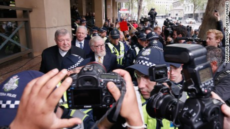 Cardinal George Pell leaves the Melbourne Magistrates' Court with a heavy Police escort on October 6 in Melbourne.