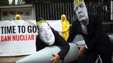 "FILE - In this Sept. 13, 2017 file photo activists of the International Campaign to Abolish Nuclear Weapons (ICAN) protest against the conflict between North Korea and the USA with masks of the North Korean ruler Kim Jong Un, left, and the US president Donald Trump, right,  in front of the US embassy in Berlin, Germany. The International Campaign to Abolish Nuclear Weapons wins the Nobel Peace Prize. The Norwegian Nobel Committee honored the Geneva-based group ""for its work to draw attention to the catastrophic humanitarian consequences of any use of nuclear weapons and for its ground-breaking efforts to achieve a treaty-based prohibition of such weapons."" (Britta Pedersen/dpa via AP)"