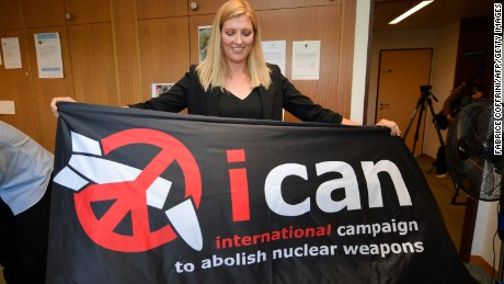 Nuclear disarmament group ICAN executive director Beatrice Fihn holds a banner with their logo after ICAN won the Nobel Peace Prize.