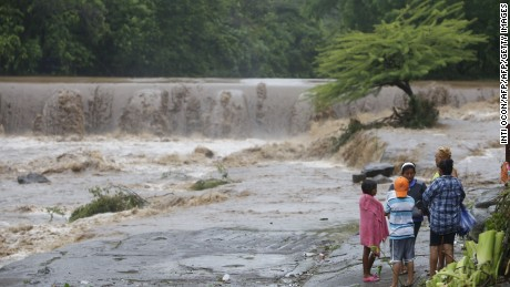 Residents look at the floodings of the Masachapa River following the passage of Tropical Storm Nate in the city of Masachapa, about 60km from the city of Managua on October 5, 2017. A tropical storm sliding north along Central America Thursday has unleashed heavy rains killing at least nine people in Costa Rica and Nicaragua, with forecasters predicting it could strengthen into a hurricane headed for the United States. / AFP PHOTO / INTI OCON        (Photo credit should read INTI OCON/AFP/Getty Images)