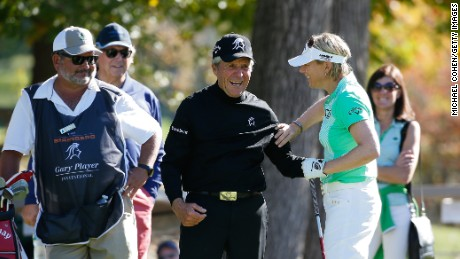 Sorenstam plays a round with Gary Player in 2015.