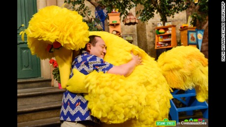"""These big feelings are OK,"" shop owner Alan tells Big Bird in a ""Sesame Street"" video."