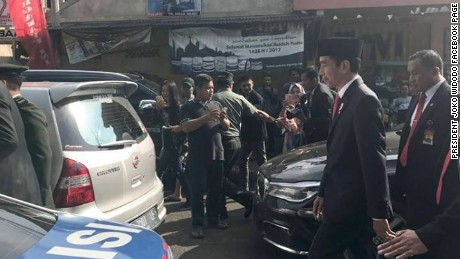 Indonesian President Widodo walks to event after being stuck in major traffic jam.