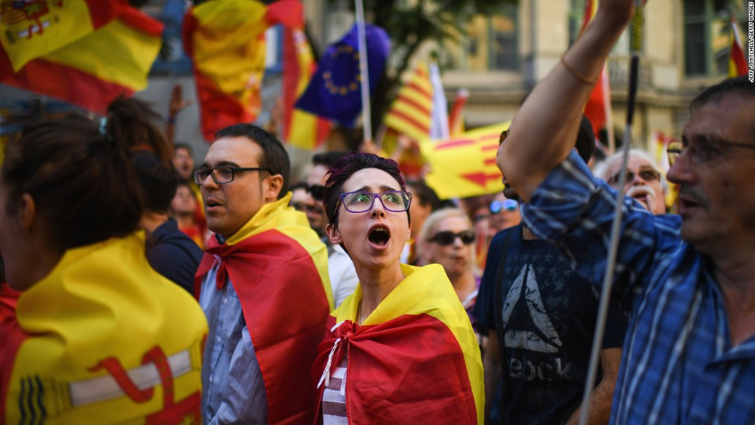 Protesters march through Barcelona during a demonstration to support the unity of Spain on October 8. A bitterly contested independence referendum on October 1 has stoked fierce divisions in the northeastern region of Catalonia and across Spain.